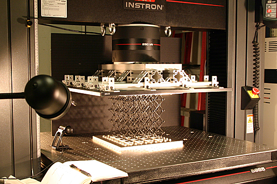 In the lab, a sample of the cellular composite material is prepared for testing of its strength properties.